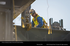 A Fluor employee works on the Unit 3 turbine building.