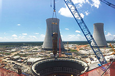 Looking from atop the Vogtle Unit 3 turbine building, the first steam generator is placed inside the Unit 3 containment vessel.