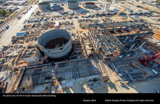 An aerial view of Unit 4 nuclear island and turbine building.
