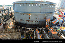 An elevated view of Unit 3 containment from the turbine building.