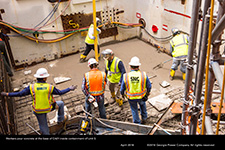 Workers pour concrete at the base of CA01 inside containment of Unit 3.