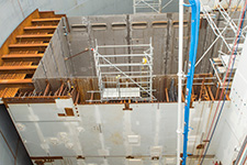 Workers pour concrete as part of the 87-foot, 6-inch placement in the east side of containment of Unit 3.