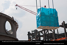 The KBO4 module, the first mechanical module to be installed in Unit 4's nuclear island, is lifted into place.