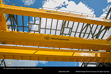 An overhead gantry crane spans the Unit 3 turbine building.