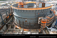 From above, the Unit 3 containment vessel rises above the work site.