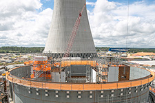 The Unit 3 containment vessel with cooling tower in the background.