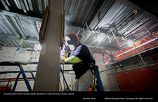 A construction team member welds equipment inside the Unit 3 nuclear island.