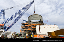 Using the heavy lift derrick, the 2.4-million-pound Vogtle Unit 3 middle ring is placed inside the nuclear island.