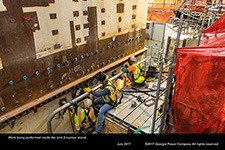 Work being performed on the steam generator cavity in the Unit 3 nuclear island.
