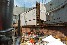Only a few feet remain until the CA05 module is set inside the containment building.