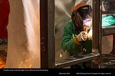 A welder works inside the Vogtle 3 and 4 Modular Assembly Building.