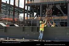 Workers preparing for a lift of structural steel.