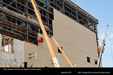 Panel installation continues on the Vogtle Unit 3 turbine building.