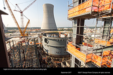 Vogtle Unit 4 containment vessel (background) and turbine building (right).