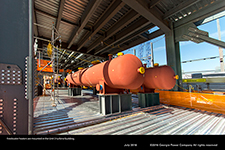Feedwater heaters are mounted in the Unit 3 turbine building.