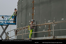 Workers prep the Vogtle Unit 3 shield building panels for fit-up and weld-out.