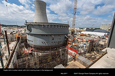 Vogtle Unit 4 nuclear island, with Unit 4 cooling tower in the background.