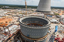 Vogtle Unit 3 containment vessel with Unit 3 cooling tower in the background.