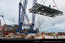 After a traditional Topping Out ceremony, the final roof truss is lifted to the top of the Unit 3 turbine building.